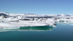 Icebergs from the glacier floating on moraine-dammed lake Stock Footage