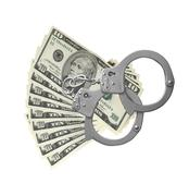 Many dollars and handcuffs isolated on white Stock Photos