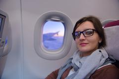 Woman in airplane travel Stock Photos