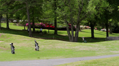 Golf course with bags azaleas and spectators Stock Footage