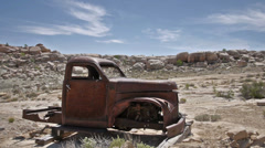 Uranium Badlands Ghost Town Relics Old Rusty Truck Wide Shot Profile Stock Footage