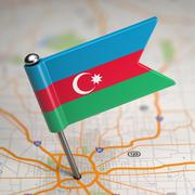 Stock Illustration of Azerbaijan Small Flag on a Map Background.