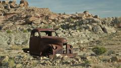 Uranium Badlands Ghost Town Relics Old Rusty Truck Wide Shot Stock Footage