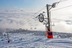 Chair lift on ski resort - stock photo