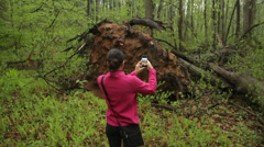 Woman Photographing Hurricane Sandy Damage on Smartphone Stock Video Stock Footage