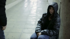 Lonely drug addict woman: saved, old man, station, neglect, abandon - stock footage