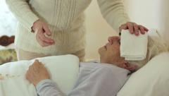 old wrinkled woman laying in bed: assistance, illness, sickness, disease - stock footage