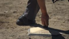Baseball homebase umpire cleaning Stock Footage