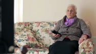 Stock Video Footage of old woman is watching tv: aged, television, senior, sitting, see
