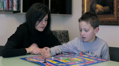 Cute boy and mother playing together at home: table, home, love, lifestyle Stock Footage