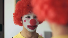 clown putting away his wig: mirror,  - stock footage