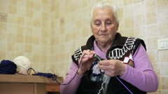 grandmother makes work: knit, wool, art, age, old, ancient, granny - stock footage