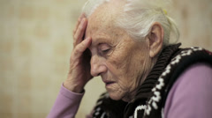 Sad senior woman thinking: trouble, old, aged, thoughtful , troubled Stock Footage