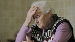Sad ancient woman: trouble, old, aged, thoughtful , troubl Stock Footage