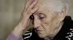 Old woman is thiking obout trouble: aged, thoughtful , troubled, ancient Stock Footage