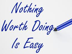 Nothing worth doing is easy on whiteboard shows determination and motivation Stock Illustration