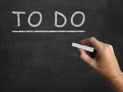 Stock Illustration of to do blackboard shows agenda and list of tasks