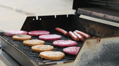Burgers and Hot Dogs on the Grill 2 1080P - stock footage