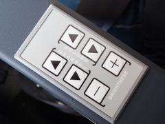 Push buttons on the armrest of airplane seat Stock Photos
