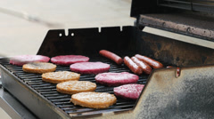 Burgers and Hot Dogs on the Grill 2 4K UHD - stock footage