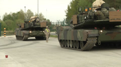 Two us army tank and walking soldiers Stock Footage