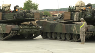 Stock Video Footage of soldier gives directions to tank driving into parking position