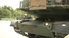 Closeup of us army abrams tank and driver Stock Footage