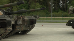 Us army abrams tank parks in formation Stock Footage