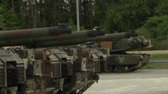Us army abrams tanks park in formation Stock Footage