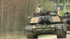 Soldier rides on top of abrams tank Stock Footage