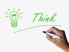 Think lightbulb means thinking learning and solving Piirros