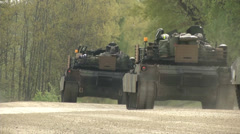 Us army abrams tanks driving in formation Stock Footage