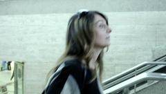 Stock Video Footage of cute woman is climbing the stairs in the railway station: travel, walking, walk