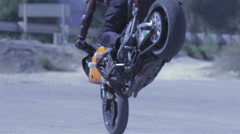 Motorcycle is standing on one wheel drivies in circle Stock Footage