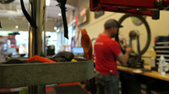 Repairman at Work in Bicycle / Bike Shop 1080P Stock Footage