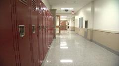 Student Walking Past Row of Lockers Stock Footage