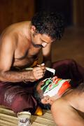 kathakali preparation - stock photo