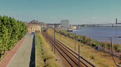 Train Seen from Above , near the river Stock Footage