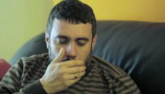 Young man has a cold: fever, sick, illness, handkerchief Stock Footage