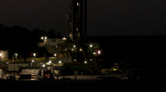 4K Oil well at night with burning flare and truck Stock Footage