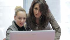 Two young girls working at the computer exult for some exciting discovery Stock Footage