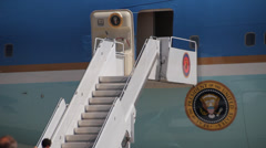 Unidentified people ascending the stairs of Air Force 1 Stock Footage