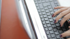 Woman typing on laptop at work: businesswoman, manicured hands Stock Footage