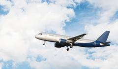 Airplane flying in a cloudy sky - stock photo