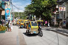motorized tricycle - stock photo