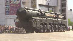 Military War Tanks and Trucks ride Moscow street. Rocket Topol. Parade. Stock Footage