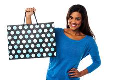 Stock Photo of Pretty young model posing with shopping bag