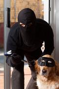 Thief stealing his accomplice - stock photo