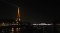 Eiffel tower and Paris at night Stock Footage