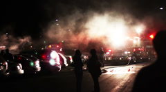 1614 Big Car Fire in Parking Lot with Fire Trucks - stock footage